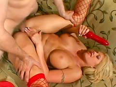 Bimbo slut in fishnets toys and takes cock