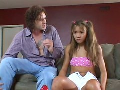 Dirty and exotic teen Keeani Lei getting dildoed on the laps of the guy