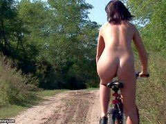 Hadjara a cute teen girl that rides the bicycle completely