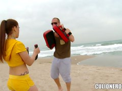 Chick fucks her fighting trainer on the beach