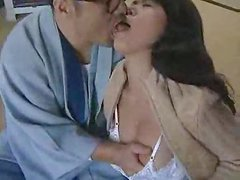 Horny Japanese milf gives a hot blowjob to her husband indoors