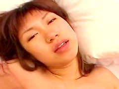 Alluring Asian babe is sucking a dick