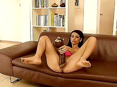 Just how much of her enormous brown dildo can Betty Stylle take in before getting brutally fisted