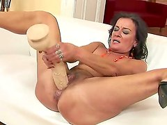 Crazy bitch Sandora plays with her pussy and penetrates it with a big toy