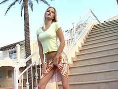 Bessy the pretty blonde masturbates on the stairs