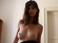 Delicious cutie with angelic face and long hair strips totally naked