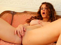 Curly beauty Karina White is stretching her shaved hole