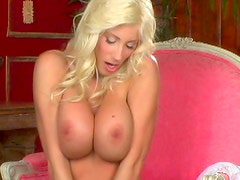 Curly blonde Puma Swede is playing with that vagina