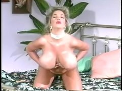 Babe rubs oil all over her huge tits
