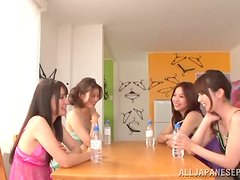 Four amazing Japanese girls in sexy nighties give pleasure to a guy