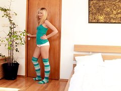Charming girl Tarra satisfies herself with fingering indoors
