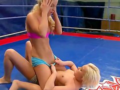 Nude fight club presents Kelly Cat Vs Lisa. Hot sweaty action as these two blonde babes wrestle in the ring together.