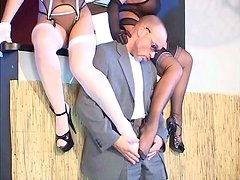 Two perverse sluts give a head to sturdy dick covered with stocking