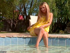 Faye Barts enjoys touching her pussy on the poolside