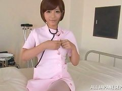 Hot Japanese nurse gives a handjob and fingers herself