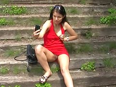 Extremely seductive European girl is rubbing her pussy in a public park