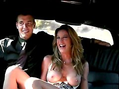 Chris Johnson and Kayla Paige sit on the back seat of the luxurious car. Pretty soon