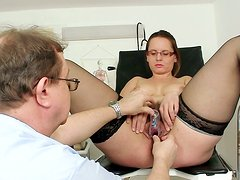 Bootylicious whorish nympho Helga wanks on the gynecological chair madly