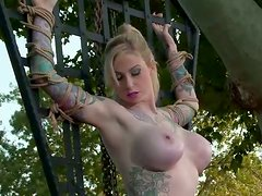 Busty skank is hogtied outdoor