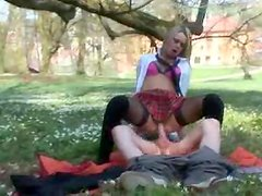 Charming blonde student enjoys upskirt banging in a forest