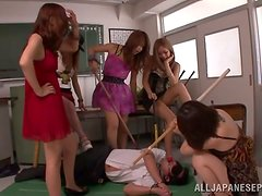 Busty Japanese girls share some guy's cock in a classroom