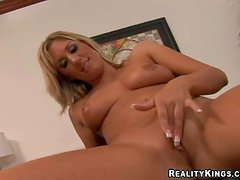 Provocative tanned blonde bimbo Jessica with natural hooters and long