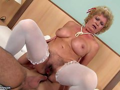 Short haired blonde granny Effie with big tits and heavy