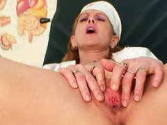 Horny mature nurse Nora dildofucking herself in the doctor's office