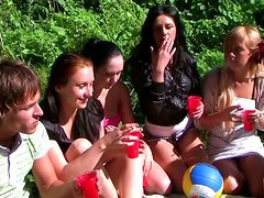 College students go wild at an outdoor group sex party