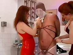 Sexy babes are humiliating their shared slave