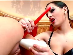 Brunette mistress pokes wet twat with a fat dildo