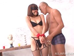 Hot Asian babe in lingerie and fishnets gets nailed