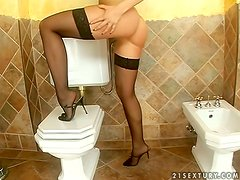 Aletta Ocean fingers her sweet pussy in the bathroom
