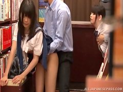 Two slutty Japanese girls get fucked in a library