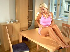 Alana the lovely blondie toys her pussy in a dining room