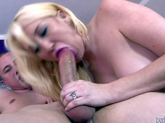 Topless blonde milf Alana Evans displays her sexy boobs as