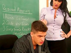 Whorable secretary Eva Karera provides a dick with a tender titfuck in office