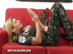 Busty blonde fills her mouth and pussy with huge dildos