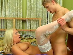 Skinny teen is fucking that slender blonde in her shaved pussy
