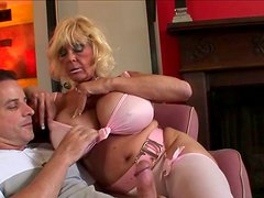 Blond and horny old clown face enjoys demonstrating her dick sucking skills
