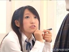 Kinky Japanese teen gives a blowjob in a classroom