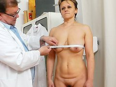 Short haired slut Tonca gets her mature pussy fingered by horny gynecologist