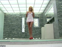 Beautiful Ivana Sugar toys her smooth vagina in indoor pool