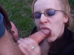 Chick in glasses sucks dick outdoors