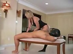 Leather gloves dominatrix gives handjob