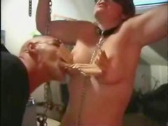 Bound girl in dungeon takes clothes pins on titties