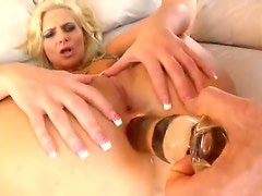 He fucks her pussy and ass with toys and cock