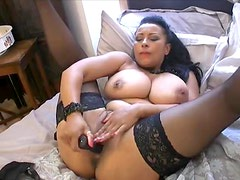 Horny British milf takes toy to cunt in bed