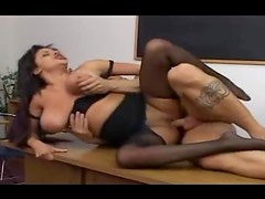Chick in ripped pantyhose fucked on her desk