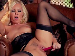 Blonde with nice lingerie is poking her trimmed pussy